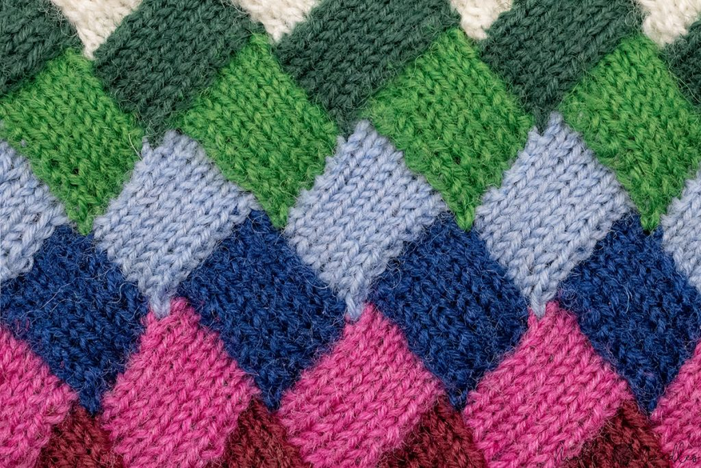 close up of a neat entrelac pattern knitted employing tips for super neat results