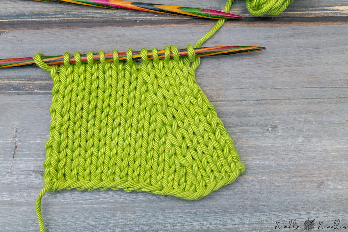 close up shot of a swatch decreased with k2tog left in green cotton yarn