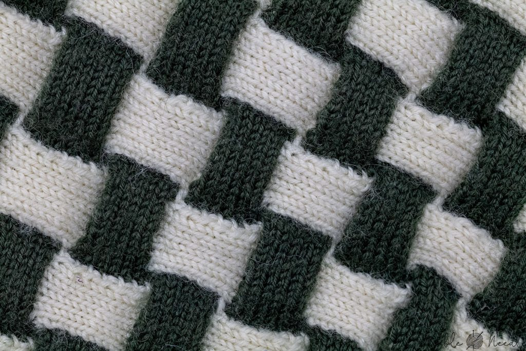 entrelac pattern in two colors with slanting corner stitches