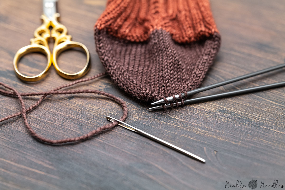 finishing the cable knit socks with a kitchener stitch