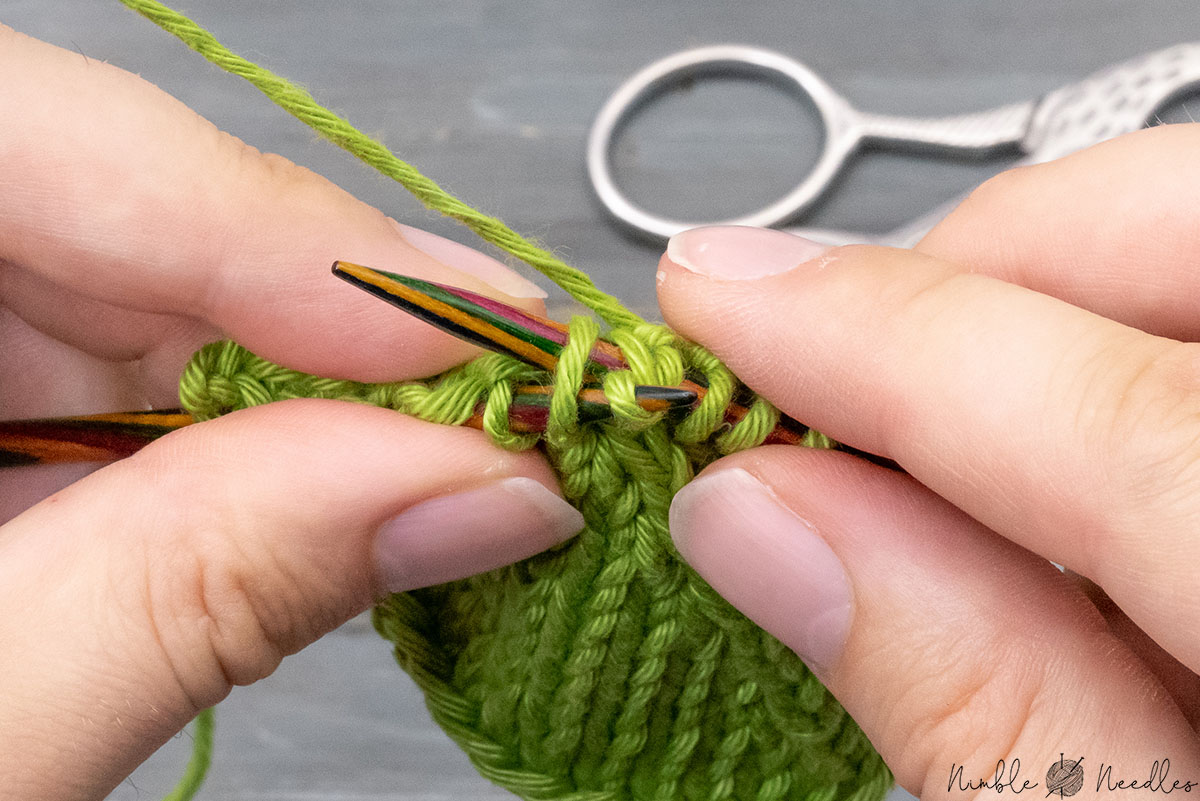 inserting the right needle into the back loop of the second stitch as well