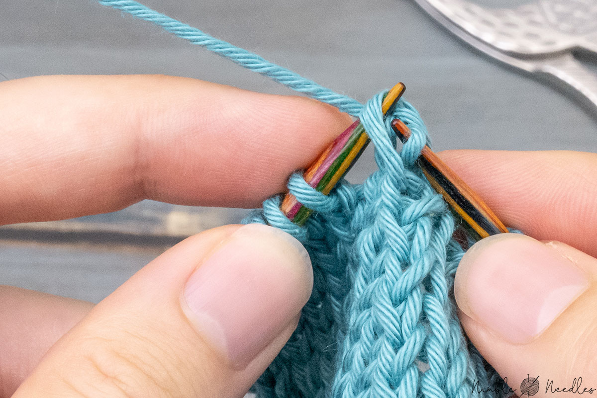 passing the slipped stitch over the one just knitted to finish skp