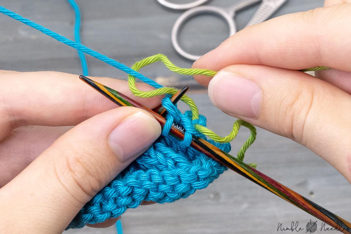 wrapping the new yarn yarn around the old working yarn clockwise