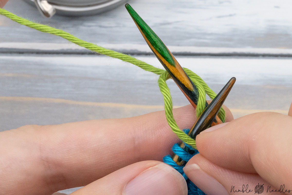 wrapping thet ail around the right needle counter-clockwise