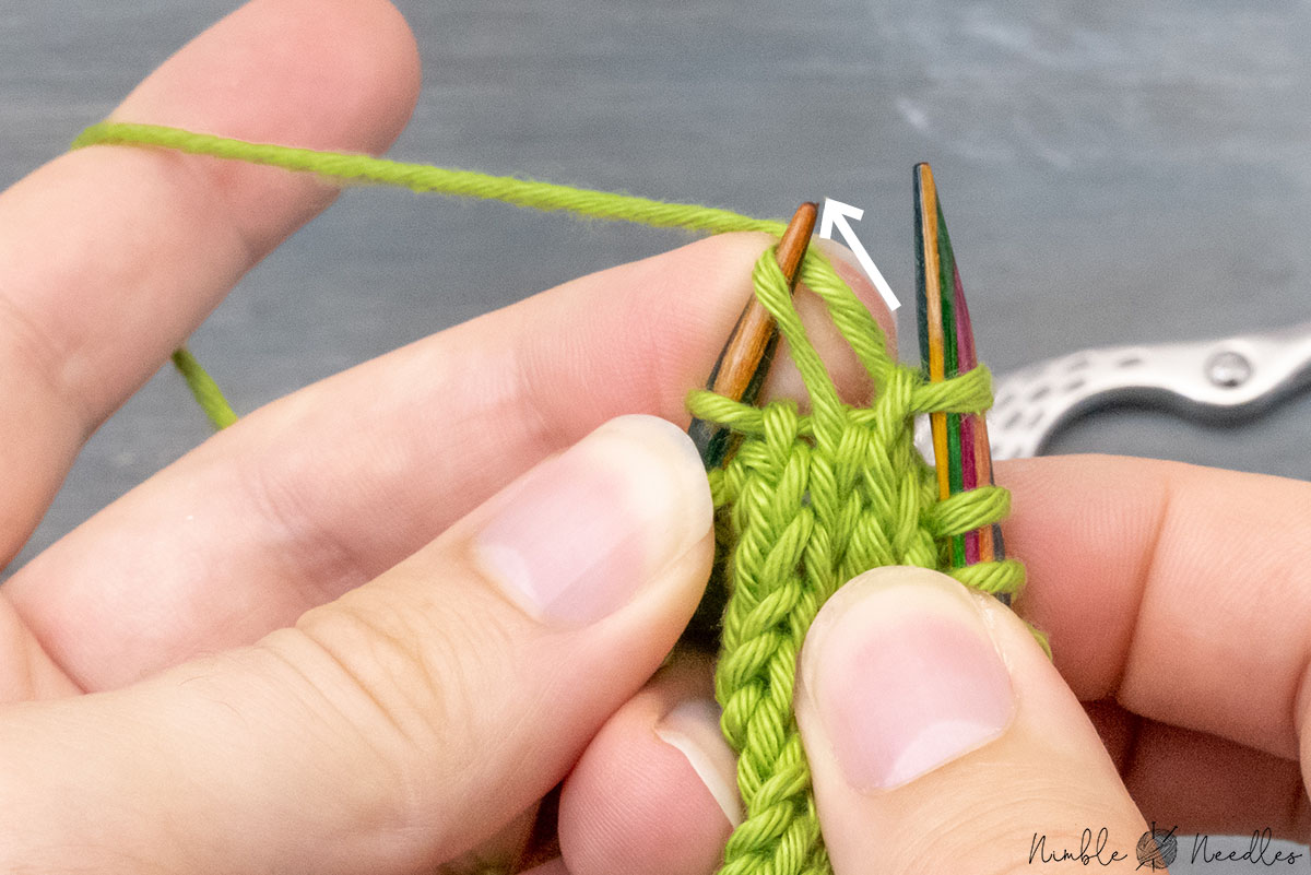 yanking on the remaining stitch on the left needle to tighten up the k2tog left