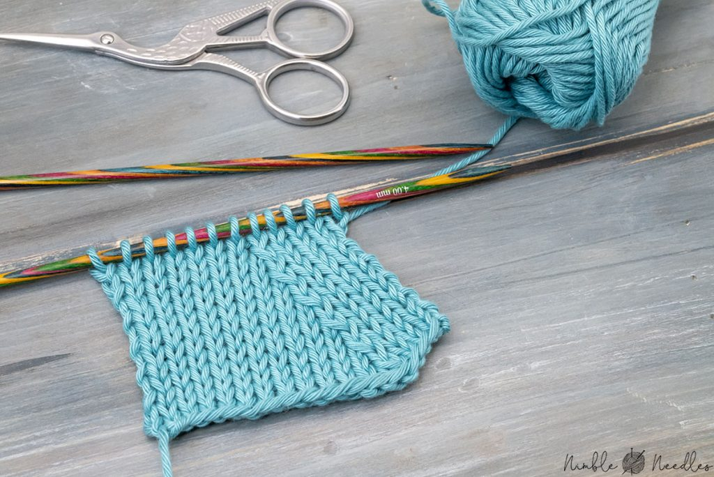 the skp knitting decrease shown on a swatch in stockinette stitch