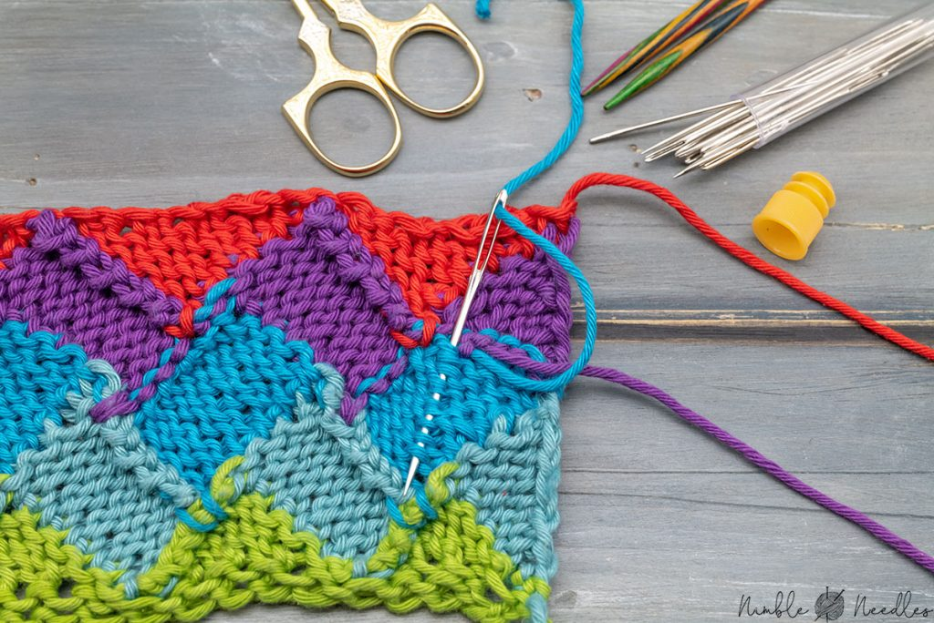 weaving in the tails on the wrong side of the entrelac knitting pattern