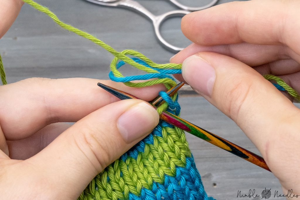 weaving in two tails as you go at the same time in knitting