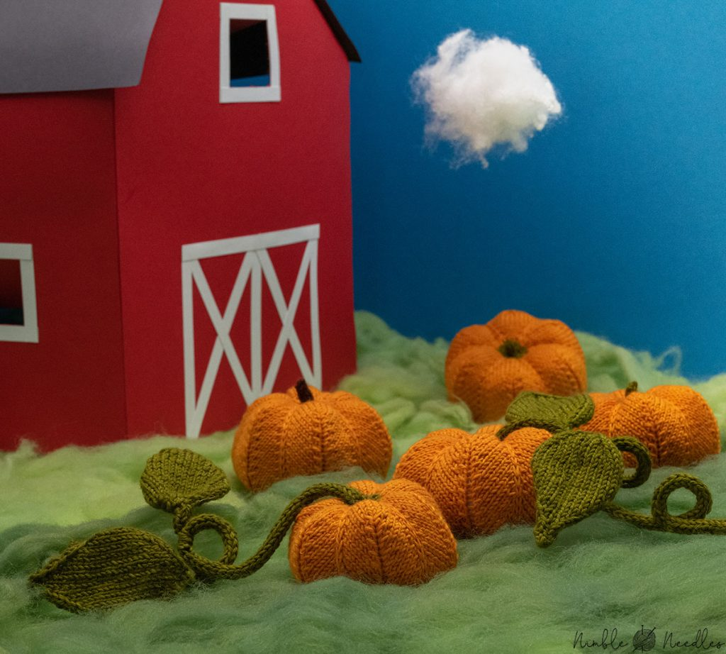 a patch full of cute knitted pumpkins