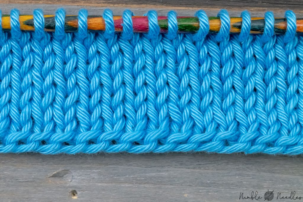 close up of a german twisted cast on on the knitting needles