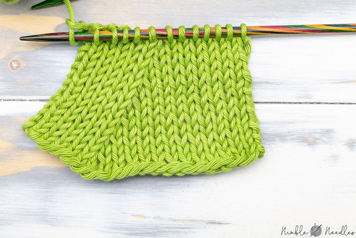 close up of a knitted swatch decreased with k2tog in every second row on the left side