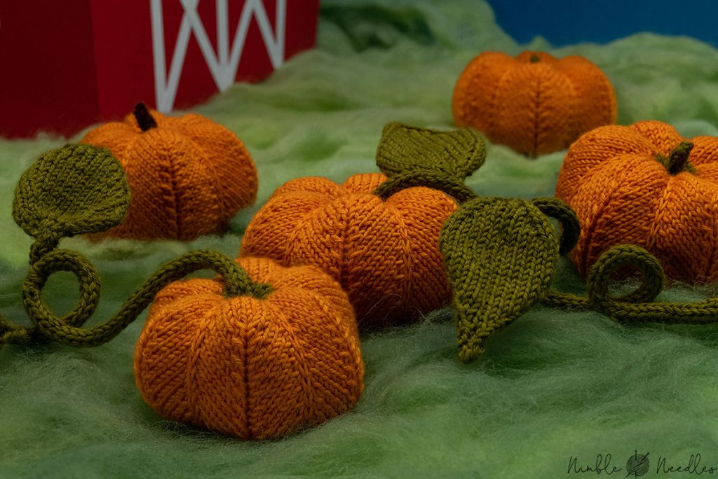 close up of the knitted pumkin patch with vines and leaves