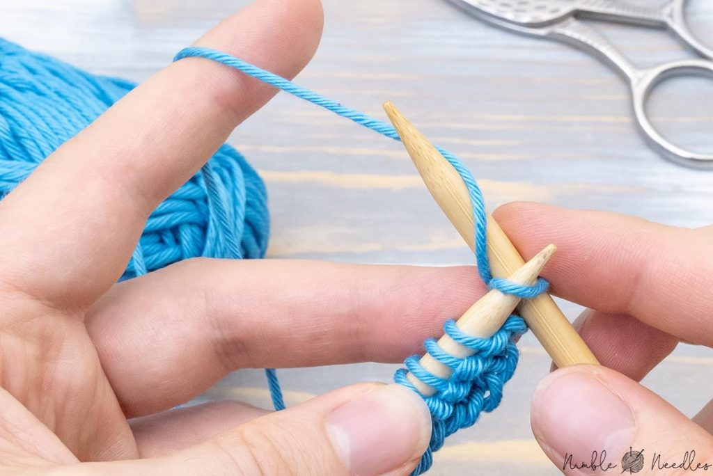 continuing knitting across the second row the same way using the knit stitch