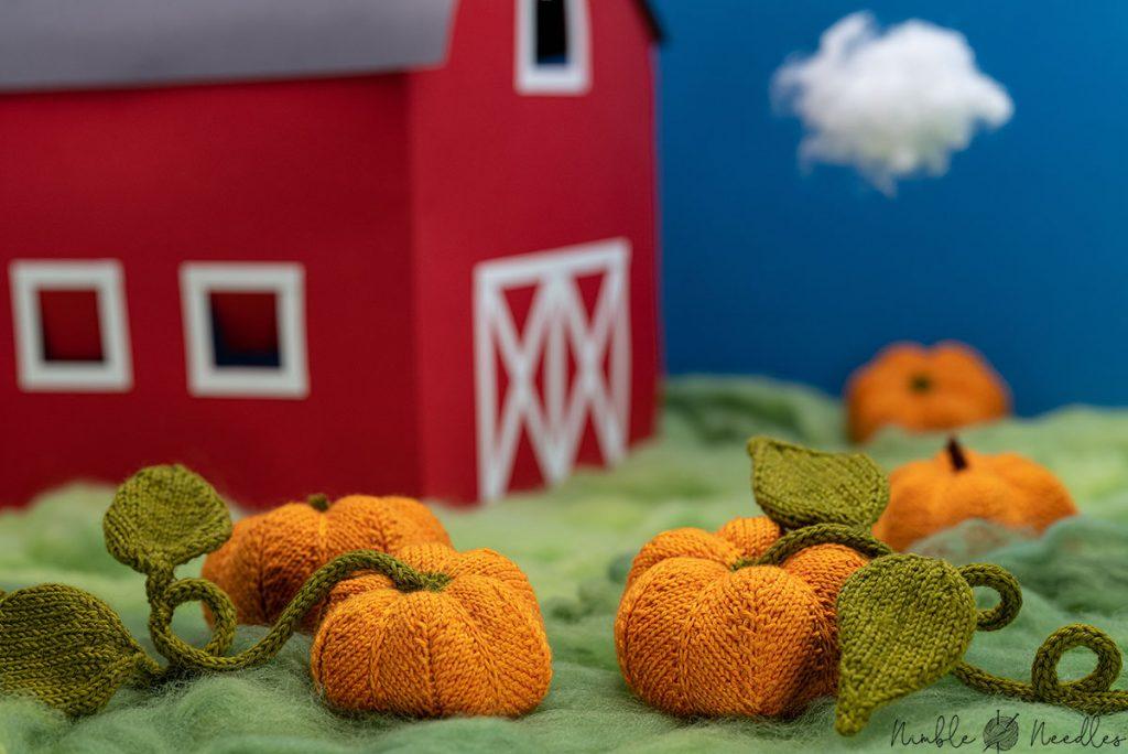 cute knitted pumpkins arranged in a diorama