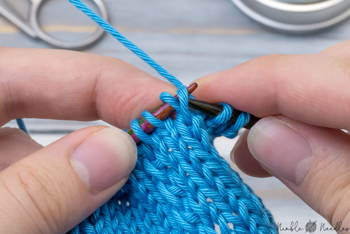 slipping the lifted stitch back to the left needle