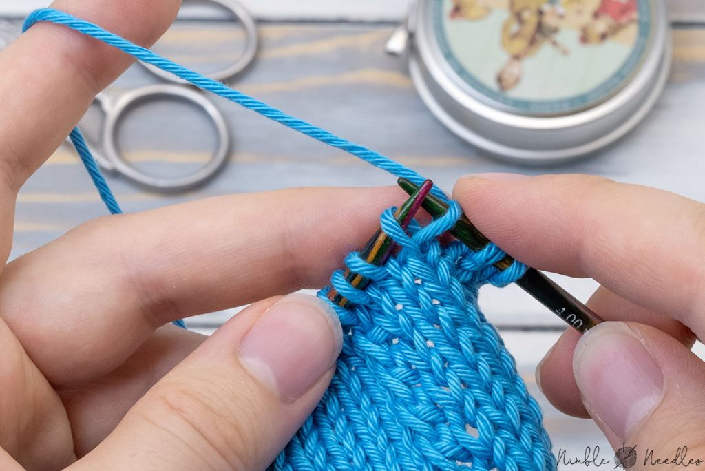 lift the left loop of the stitch you just slipped and slip the slipped stitch to the left needle