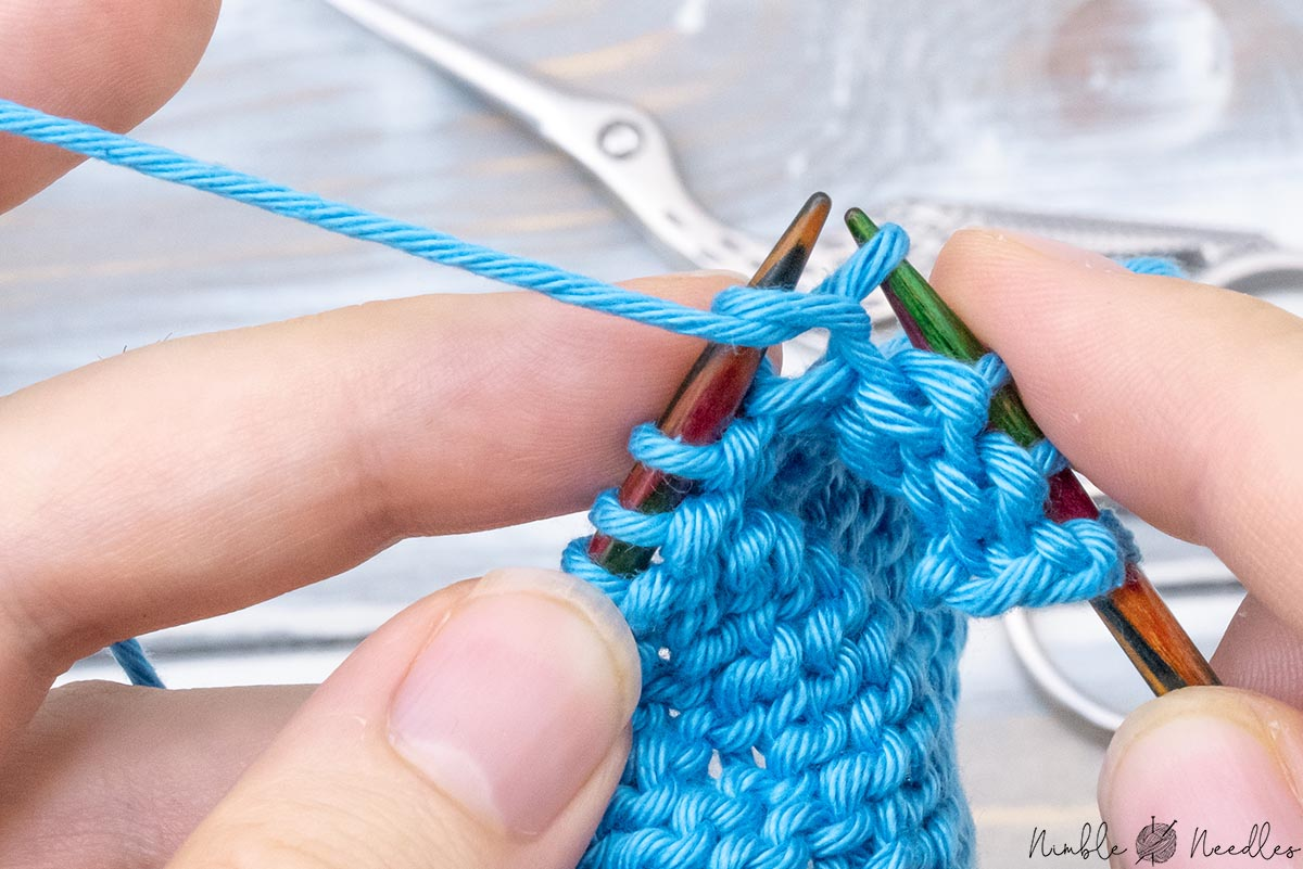 Pulling the working yarn through the loop