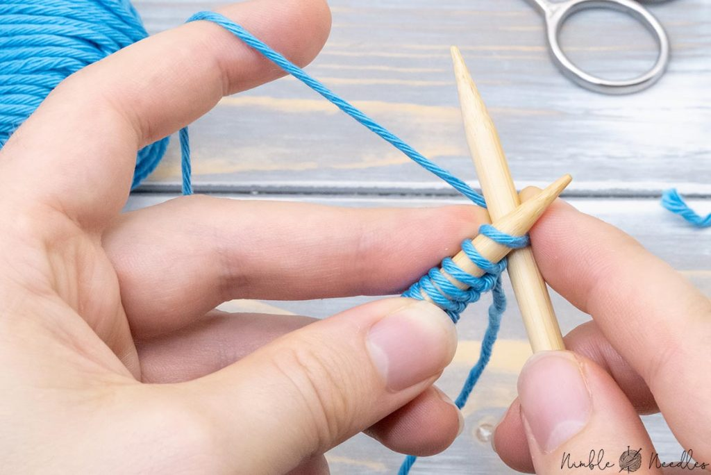 inserting the right needle into the first stitch on the left needle from left to right