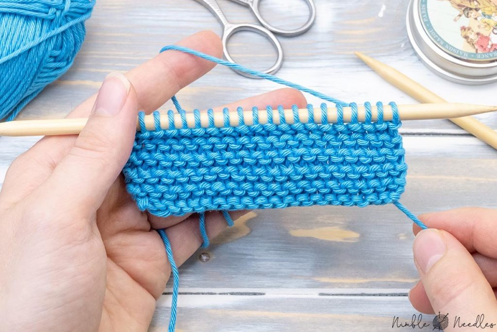 the right side of a knitted swatch in garter stitch - the pattern you should start to learn knitting